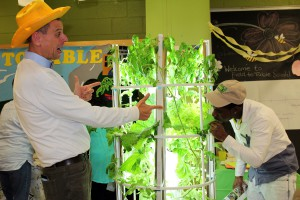 Stephen Ritz and Nadje nibble aeroponic lettuce