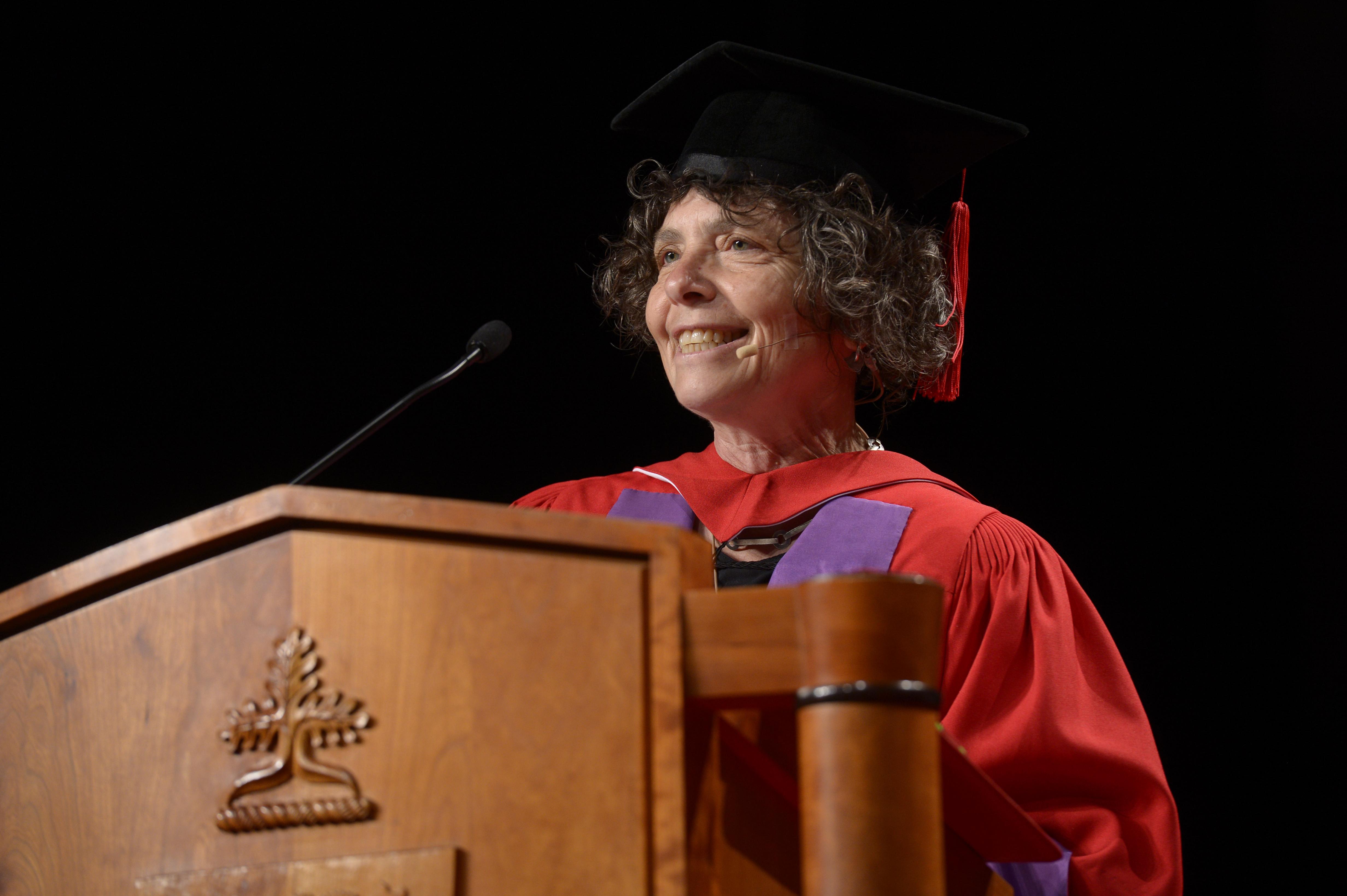 Debbie Field speaking at a podium