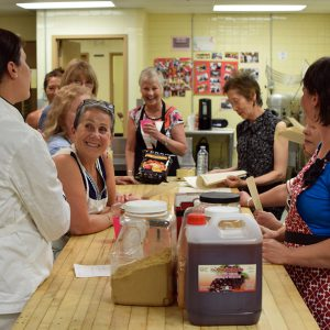 Participants learn about a new recipe at Kate's Kitchen