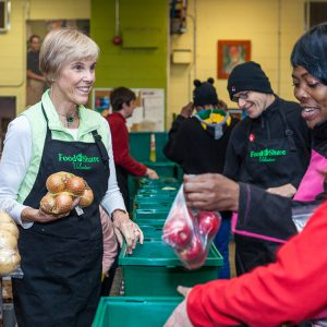 Volunteers pack Good Food Boxes with fresh vegetables and fruit