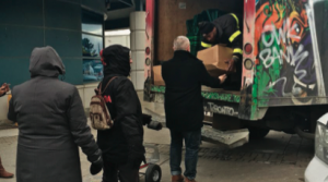 People line up to receive Good Food Boxes from a FoodShare vehicle