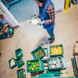 Staff member counts an order of produce